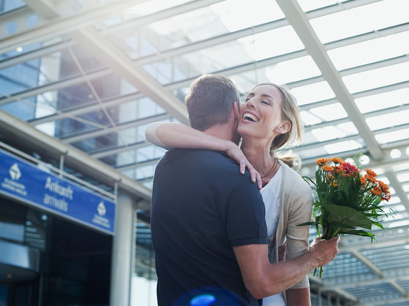 Couple Embrace at Airport
