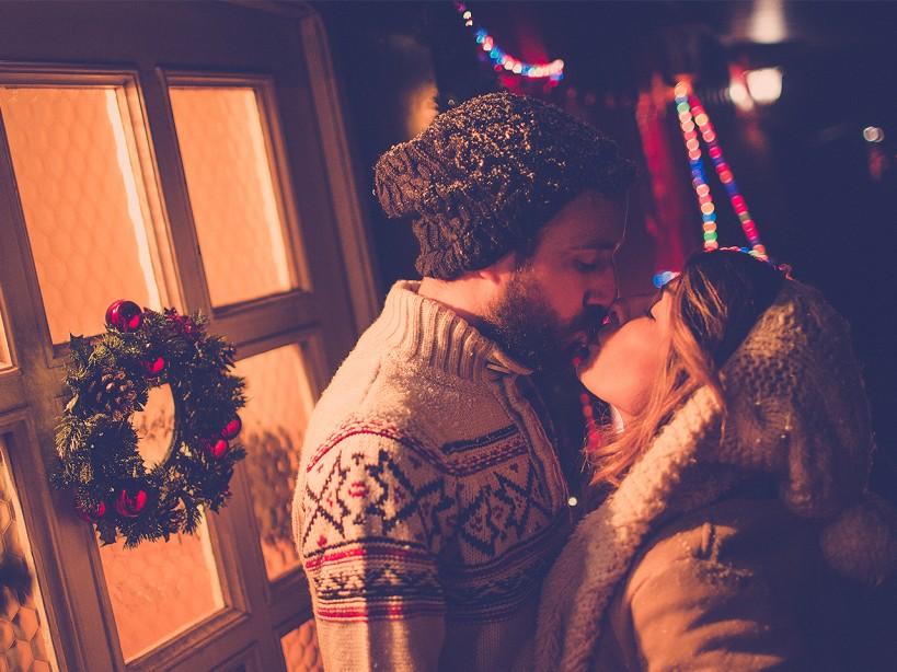 Couple Kiss Under the Mistletoe