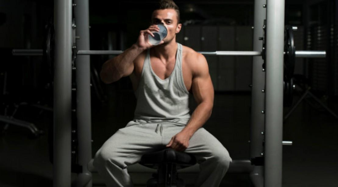 Natural Bodybuilding Supplements -- bodybuilder drinking pre workout