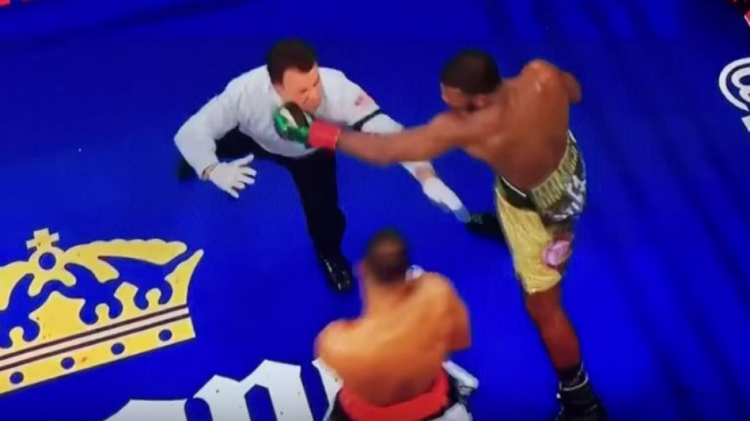 Boxer Almost Knocks Out Referee, Then Catches Him