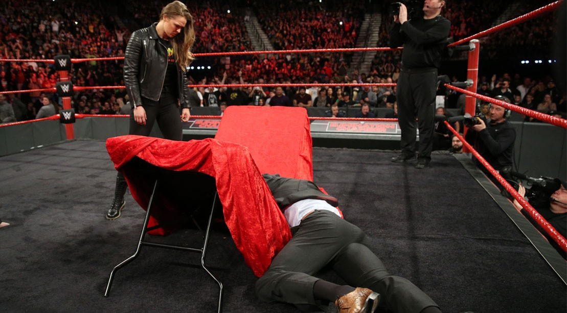 Watch: Ronda Rousey Slams Triple H Through Table, Signs WWE Contract