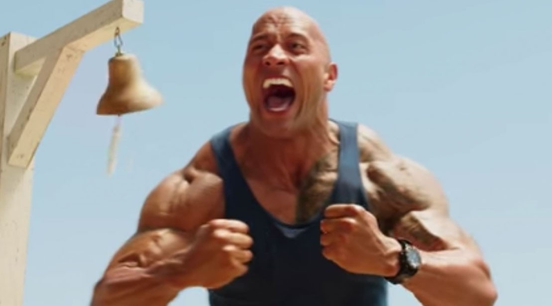 Watch: The Rock as an 'Oceanic Motherf***Er' With His Own Jacked Sand Castle in The New 'Baywatch' Trailer