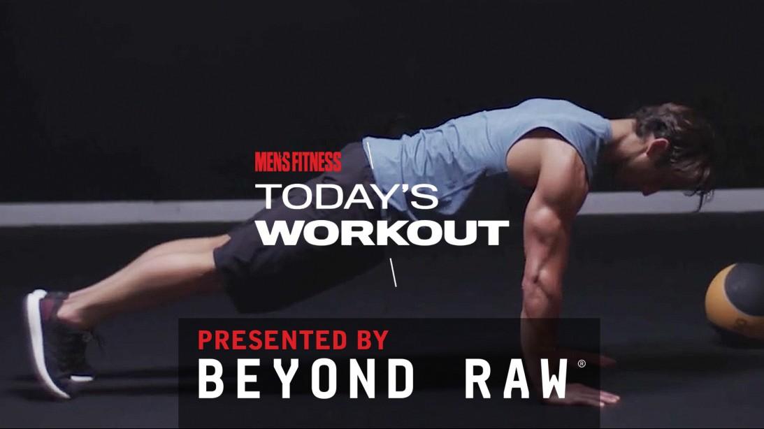 Man Does Leg Raise During Workout