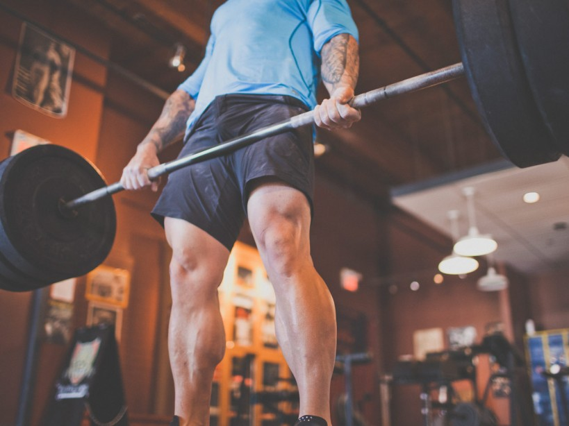 Man deadlifting barbell