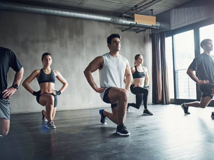 Exercise class doing lunges