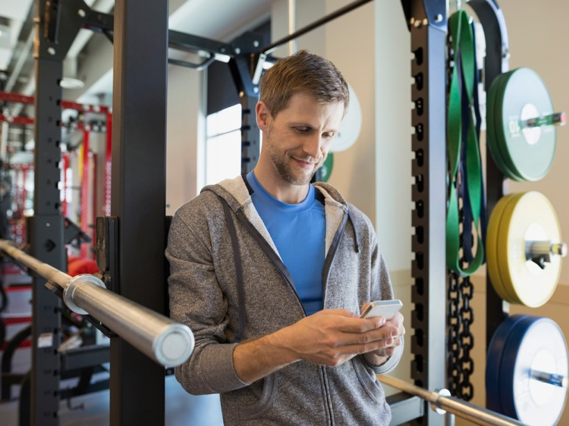 Man on phone at gym