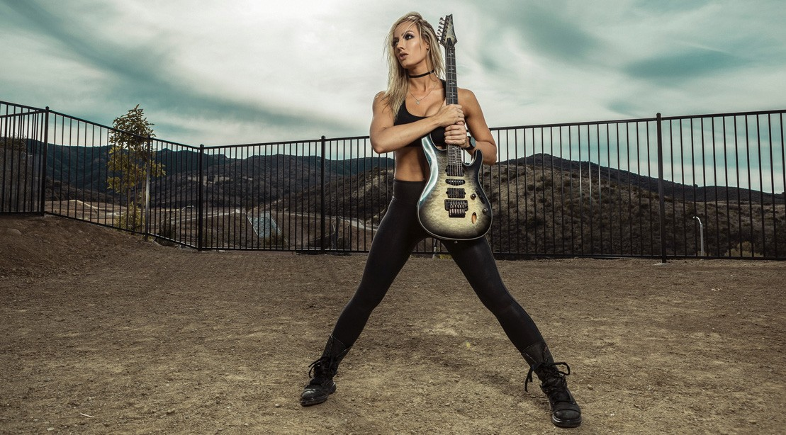 Badass Guitarist Nita Strauss Talks On-the-Go Fitness, Sobriety, and Her Upcoming Album