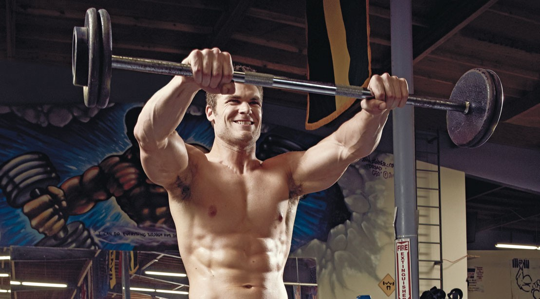 Man doing shoulder exercise: barbell front raise