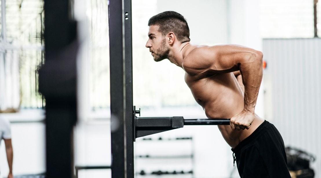 Man performing bodyweight dip