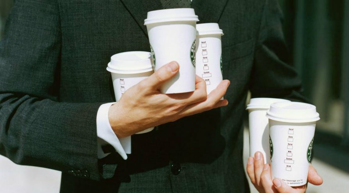 Man Holding Multiple Coffee Cups