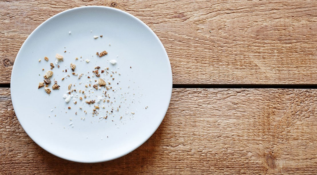 An empty plate of crumbs