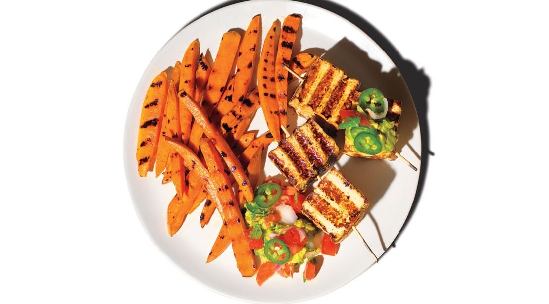 Grilled tofu with guacamole and sweet potato fries