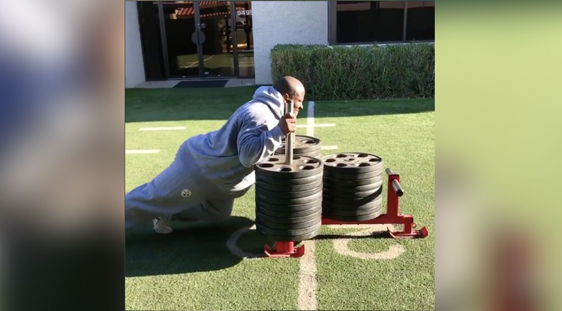 James Harrison performing a heavy sled push