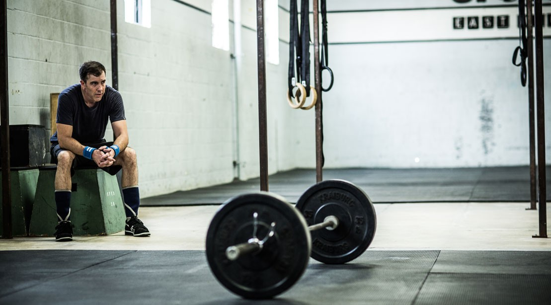 Man Tired, Resting In The Gym With Barbell