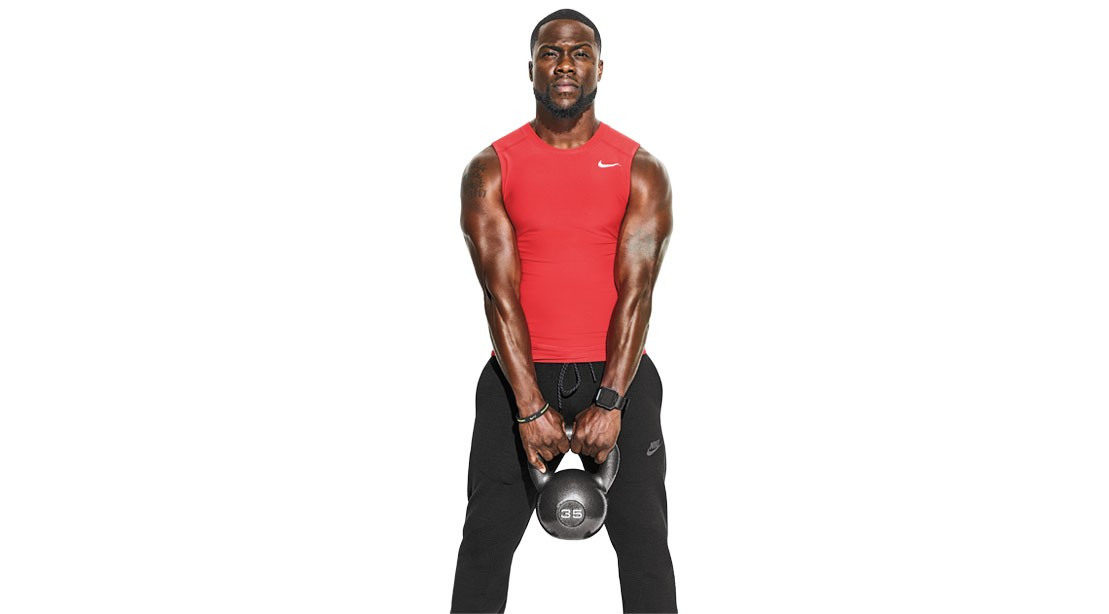 Muscular Kevin Hart holding a kettlebell with red shirt on