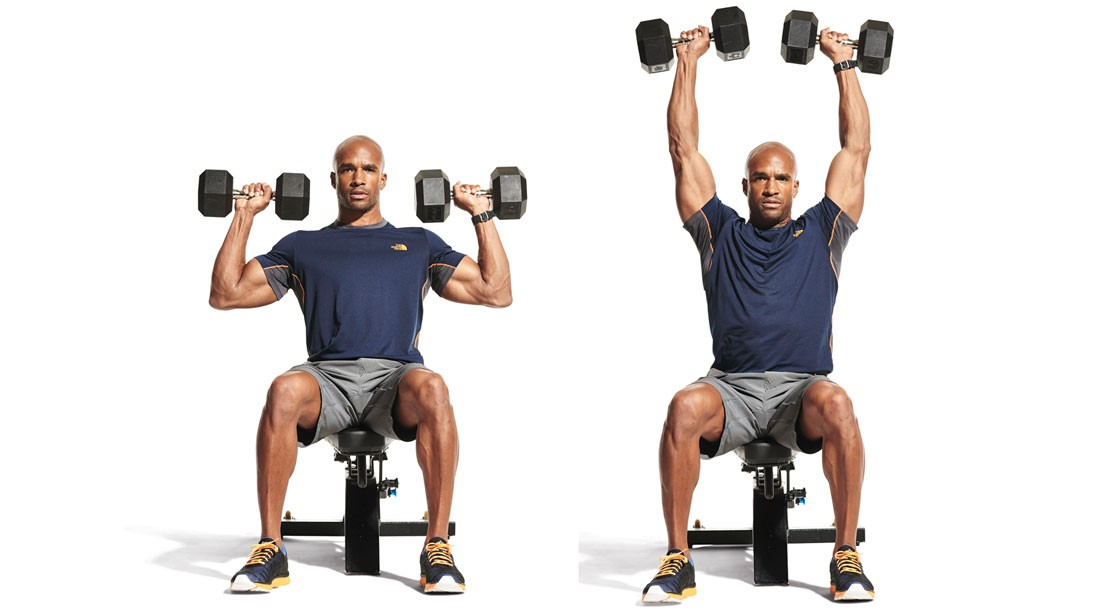 man performing seated dumbbell overhead press