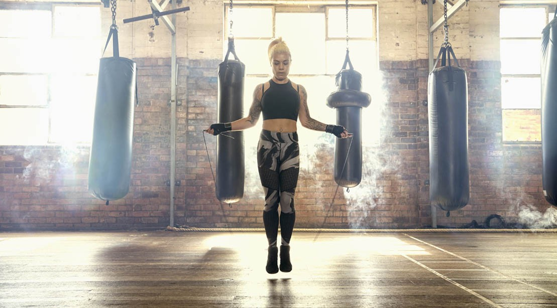 Woman jumping rope in boxing gym