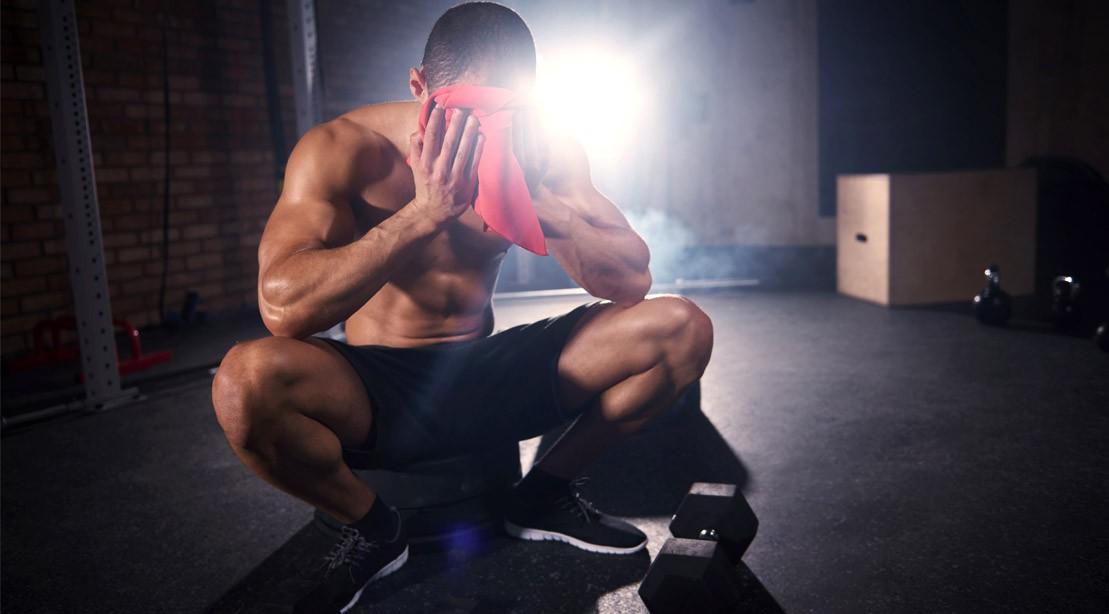 Man-Wiping-Sweat-Circuit-Training