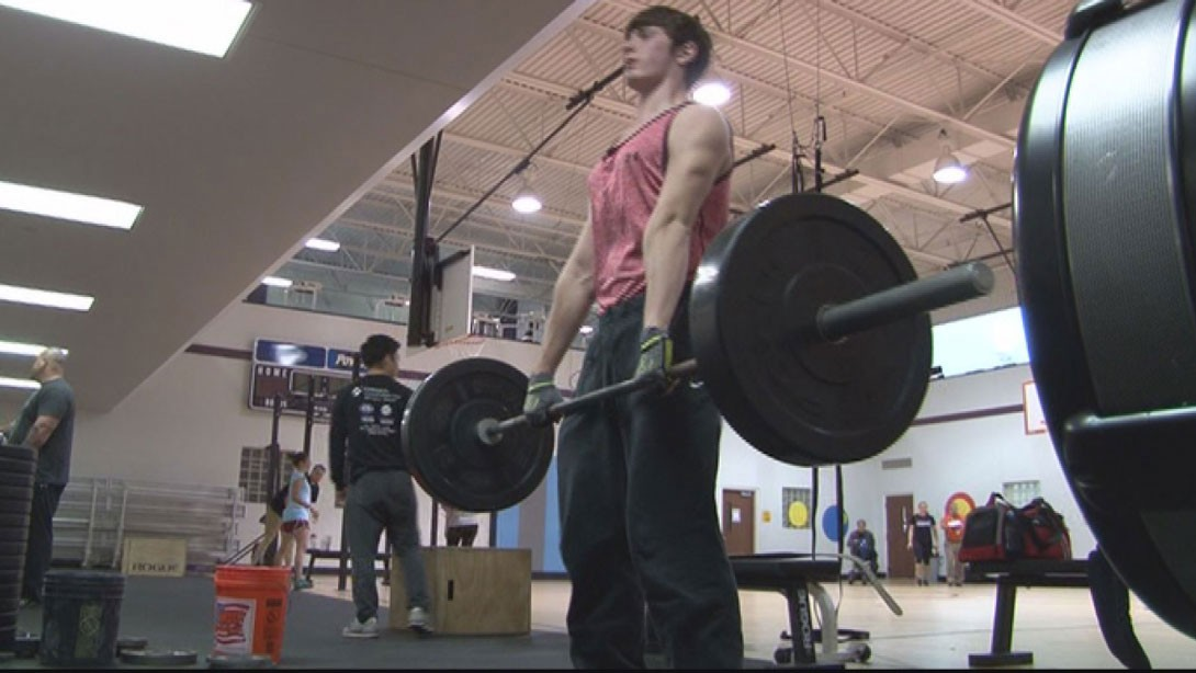 Father and Son Bond Over Weightlifting