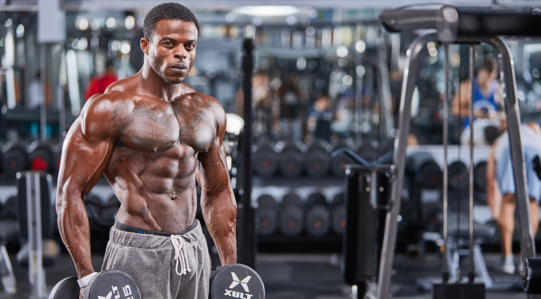 Andre Ferguson posing during his Muscle & Fitness photoshoot