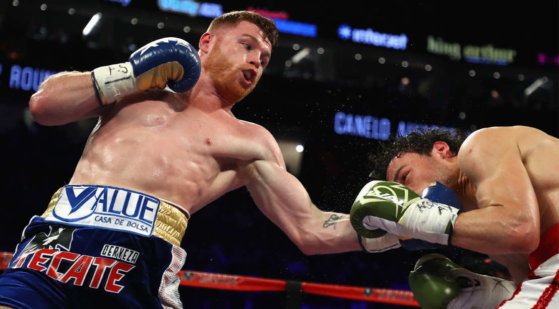 Canelo Alvarez punches Julio Cesar Chavez Jr. during their catchweight bout.