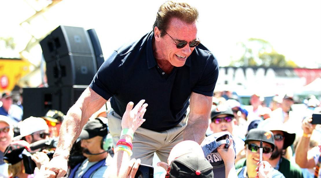 Arnold-Schwarzenegger Shaking Hands In Crowd