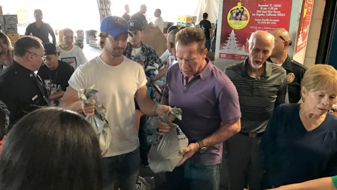 Arnold Schwarzenegger Hands Out Turkey to Homeless