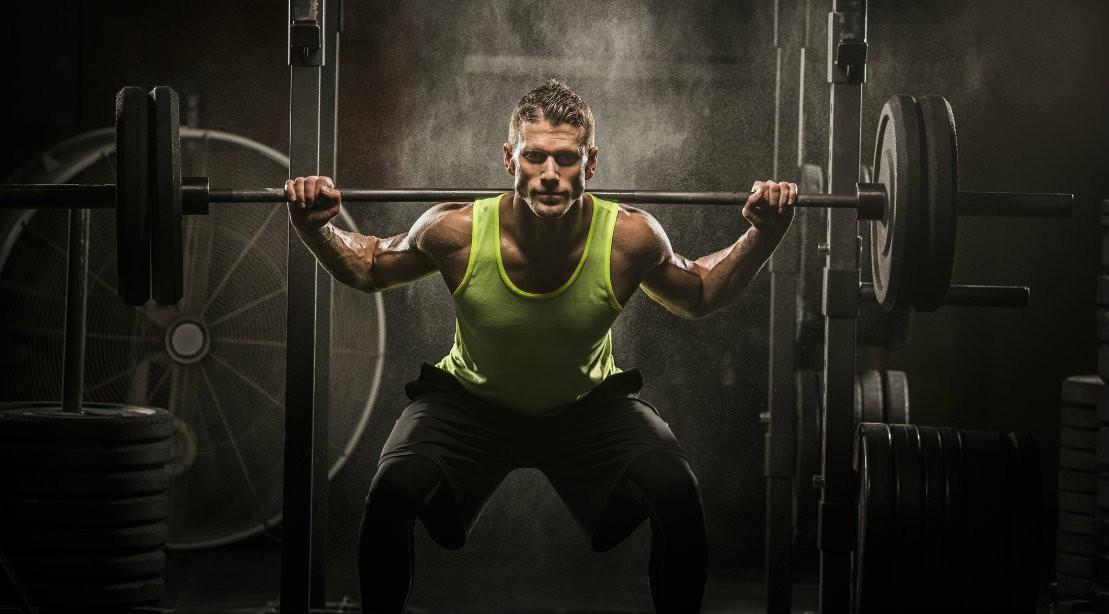 Man performing barbell back squat