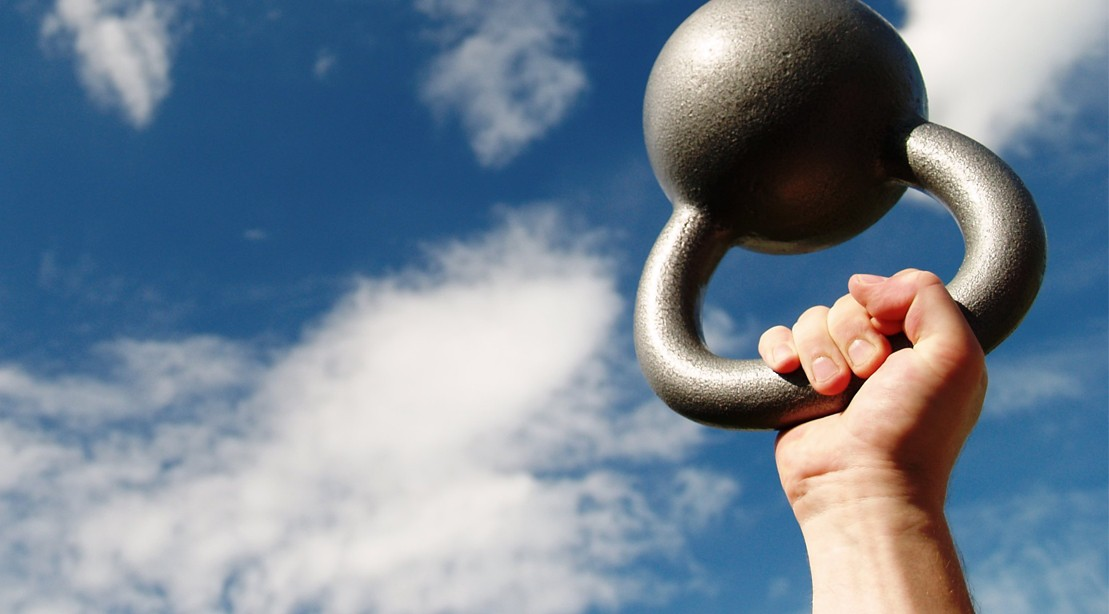 Bottoms-Up-Kettlebell-Press-Sky-Background