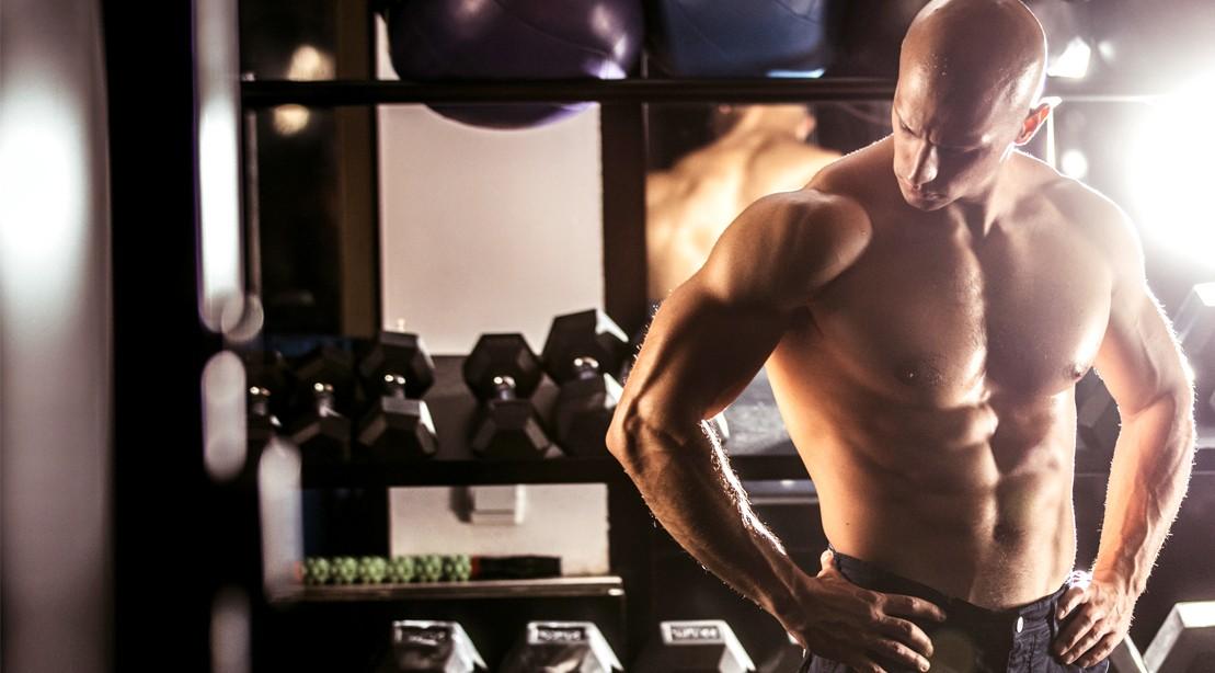 Build-Chest-Workout-Bodybuilder-Resting-Dumbbell-Rack-998035390
