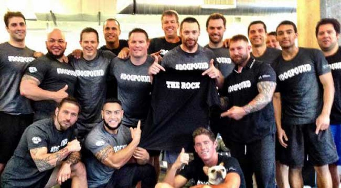 Hugh Jackman Poses with His Pack at the Dog Pound | Muscle & Fitness