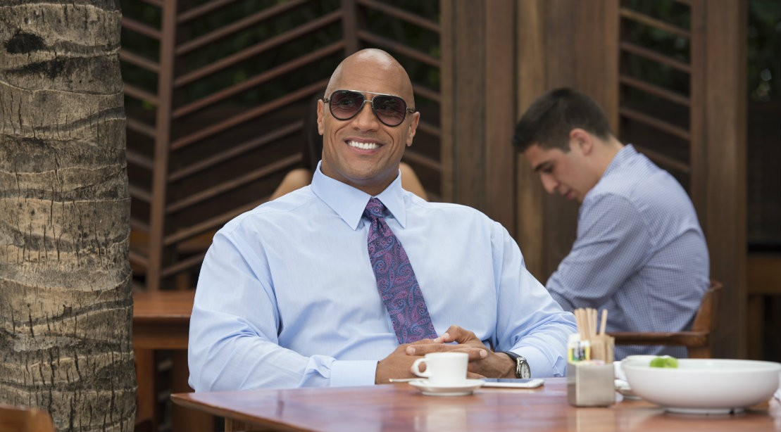 Dwayne Johnson Seated At Restaurant Wearing Tie