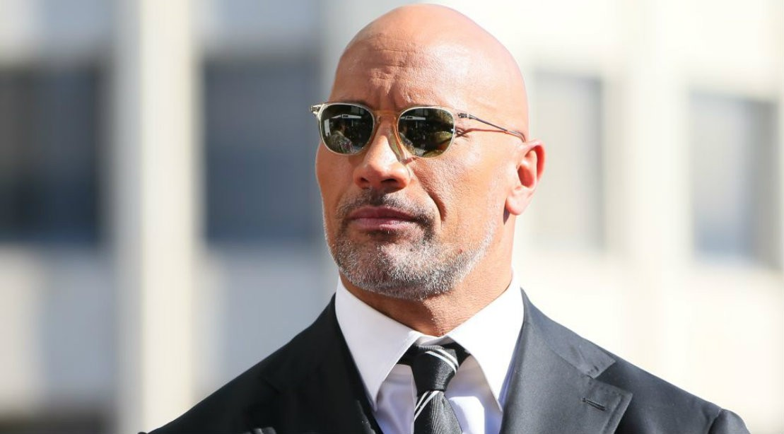 Dwayne Johnson wearing a suit