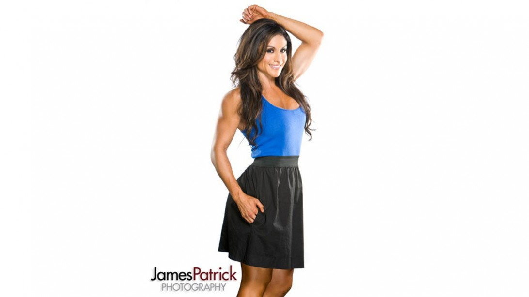 Felicia Romero in black skirt and blue top
