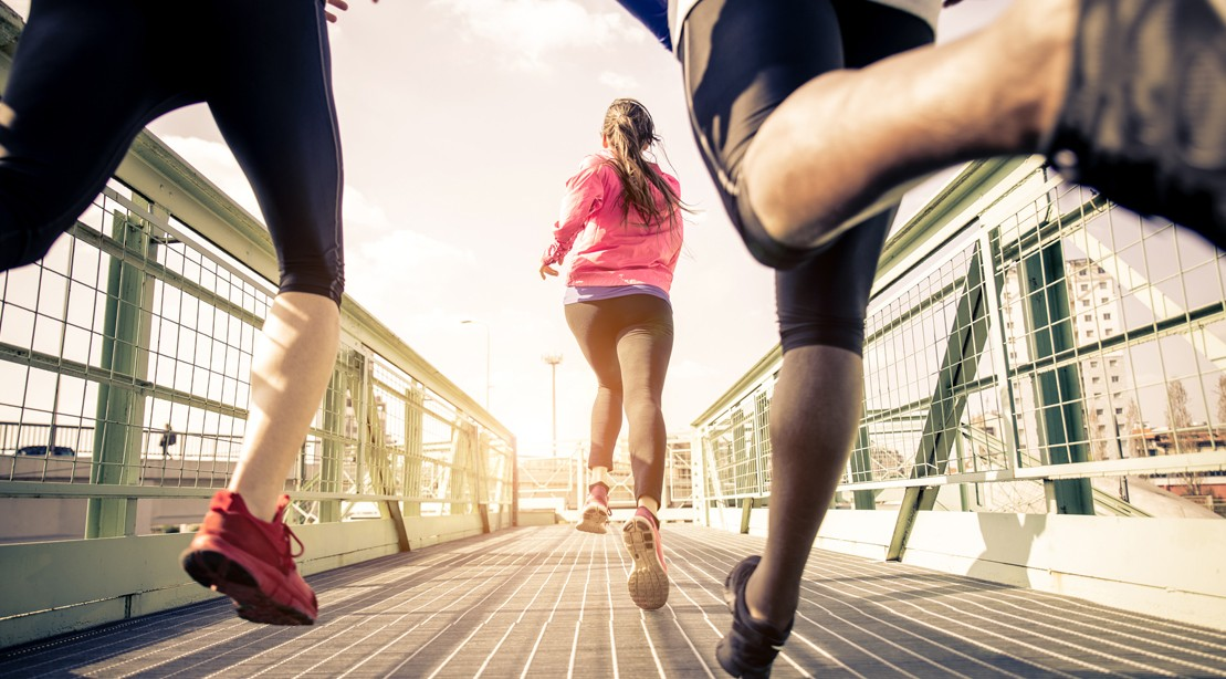 Three-People-Running-On-Bridge-Female-Focus