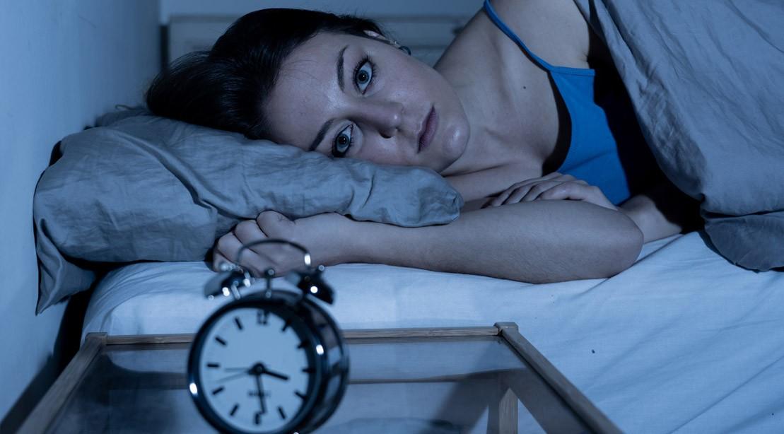Girl-In-Bed-Awake-Looking-Forward-Trying-To-Sleep