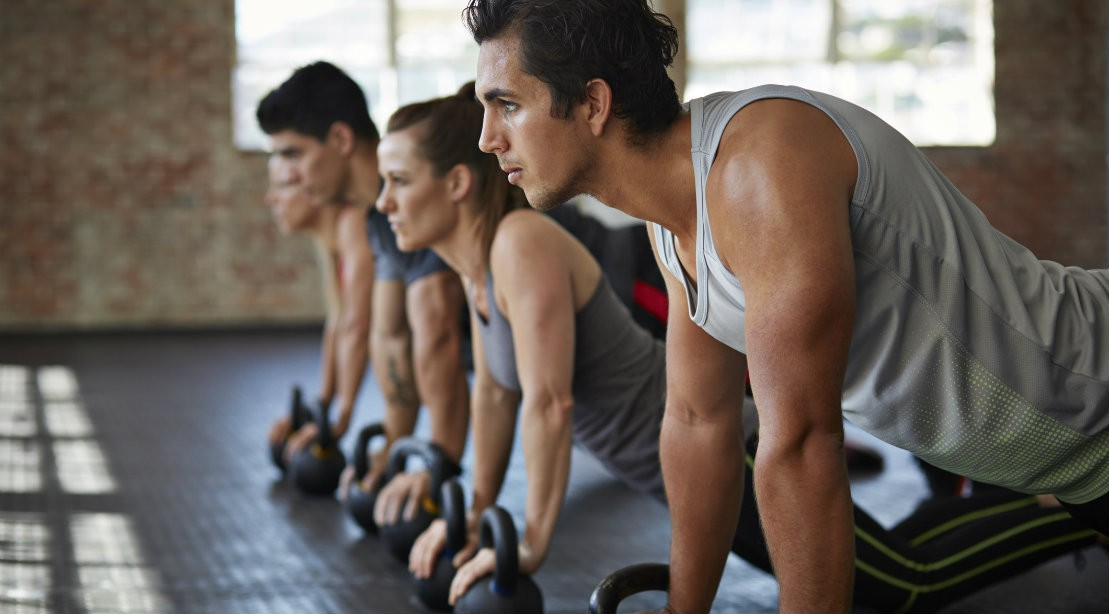 Group pushups with kettlebellls
