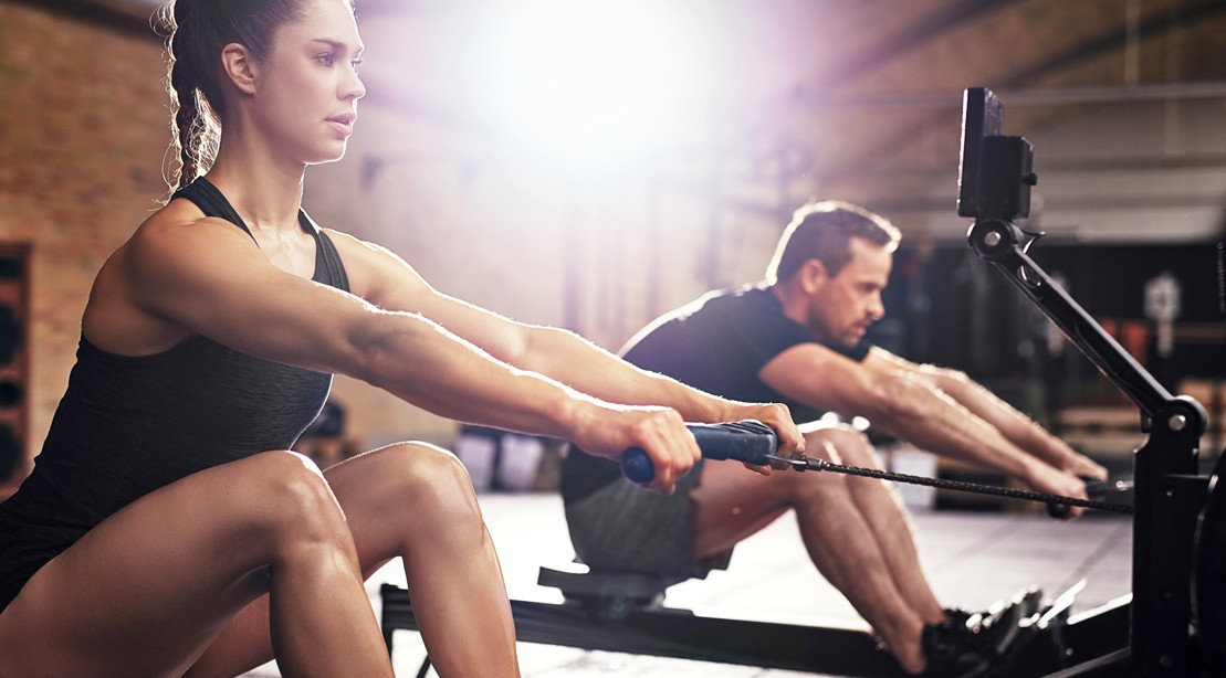 Guy-Girl-Rowing-Machine-Side-By-Side
