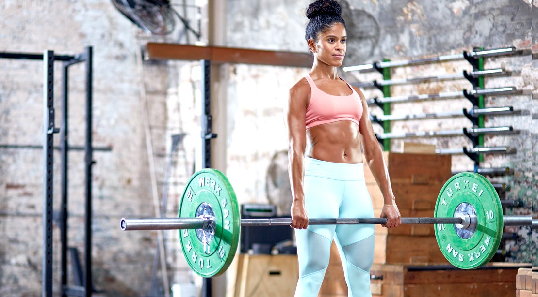 HERS Female Performing Barbell Deadlift