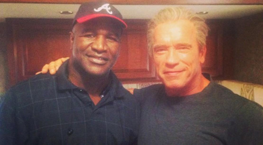 Evander Holyfield and Arnold Schwarzenegger