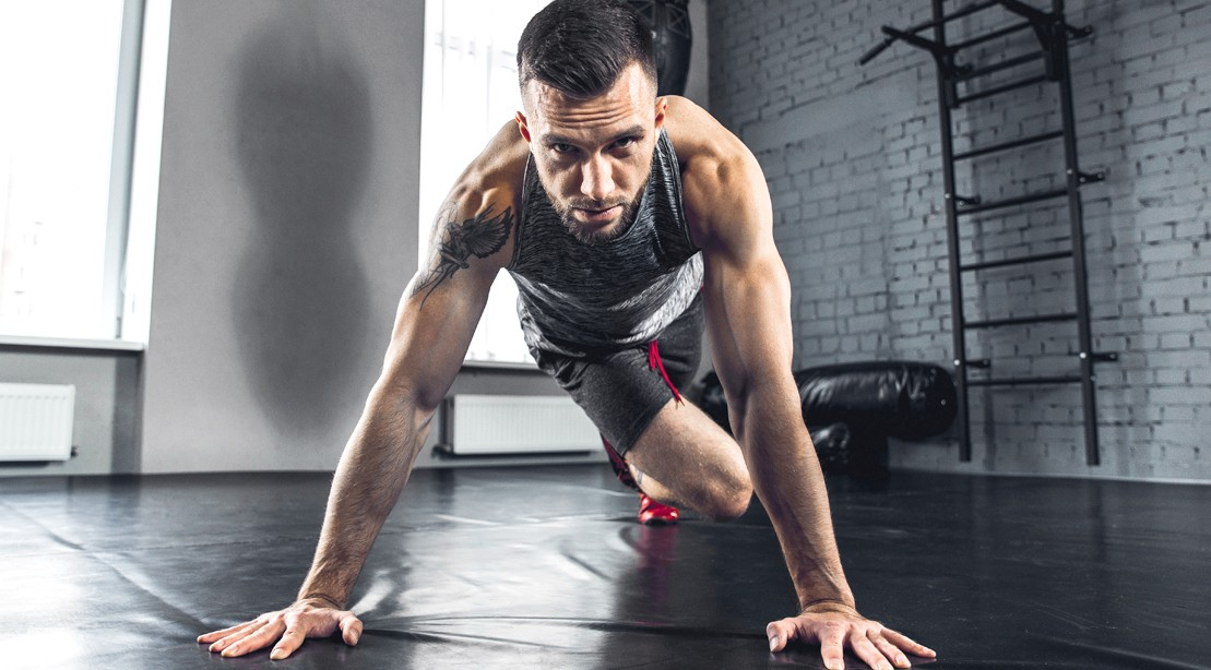 Male-With-Beard-Performing-Pushup-Knee-Tuck