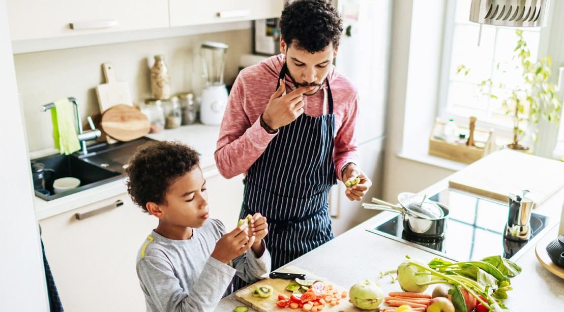 Man Cooking With Son
