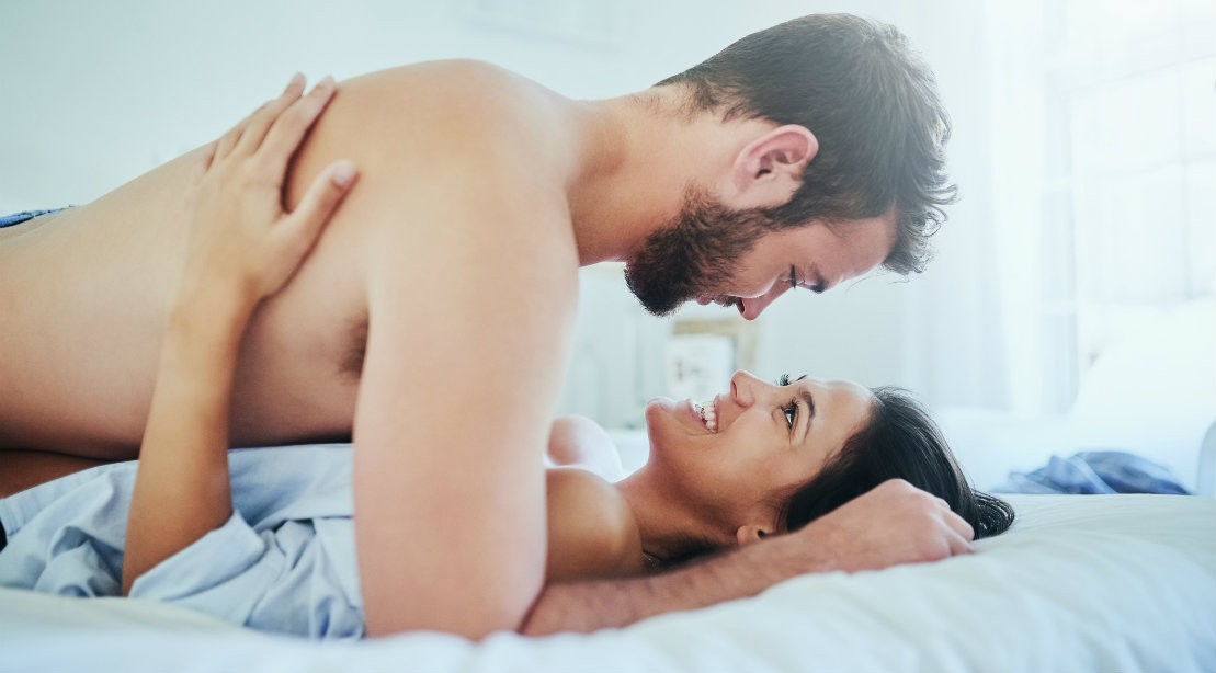 Sex man and woman in bed