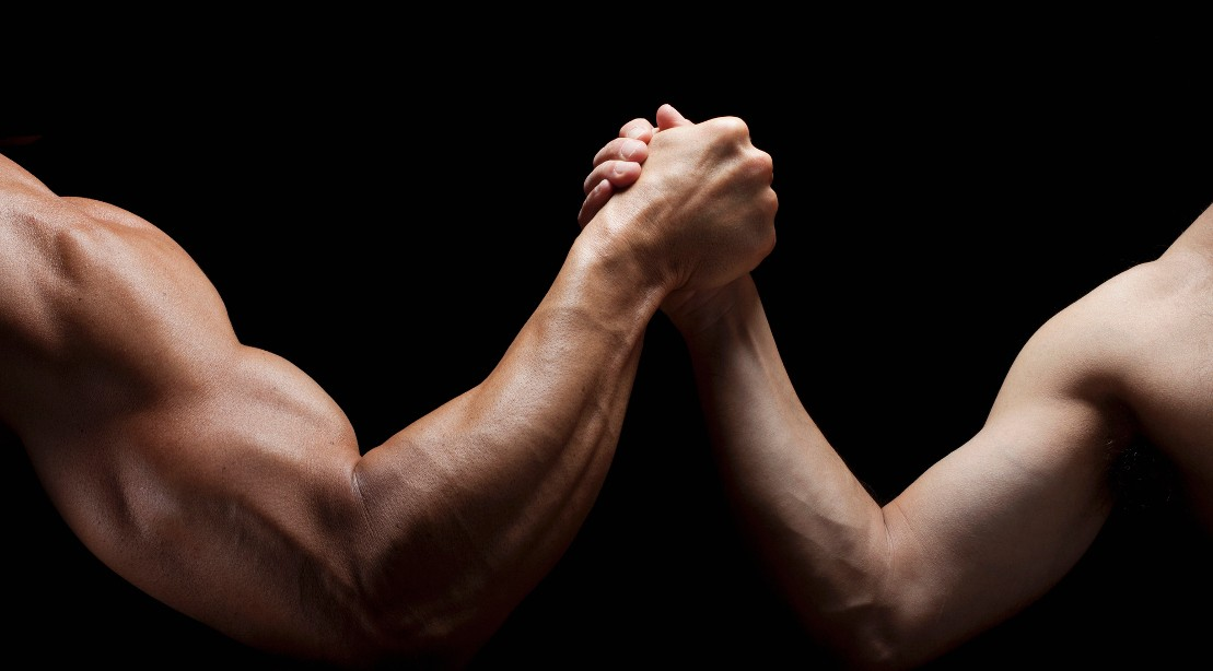 A picture of a man with a muscular arm and a man with a less-muscular arm.