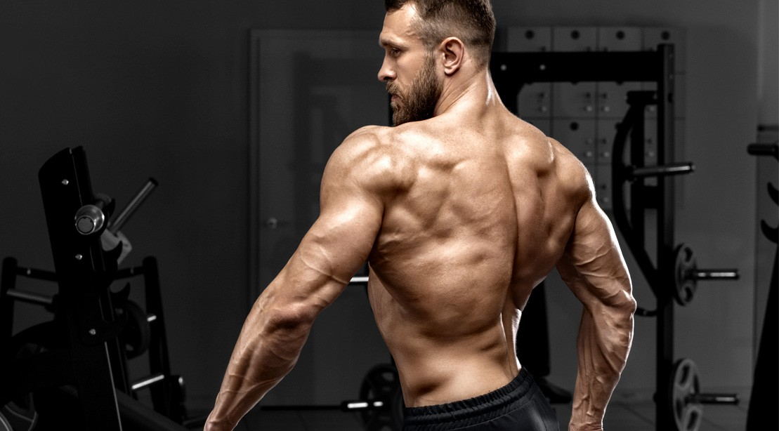 Muscular--Man-Back-Posing-Gym.