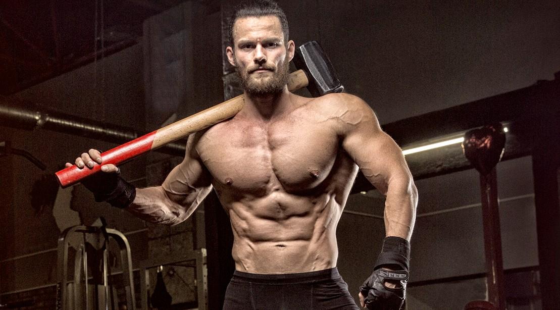 Muscular-Man-Holding-Sledge-Hammer-Brute-Strength