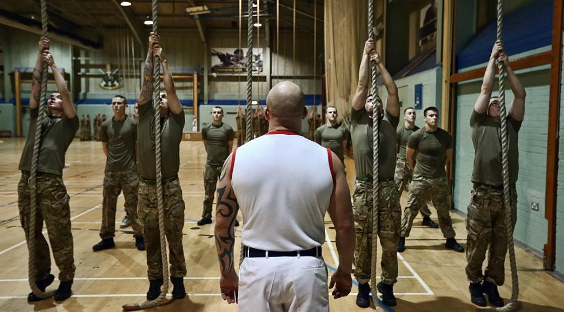 Army men climbing rope