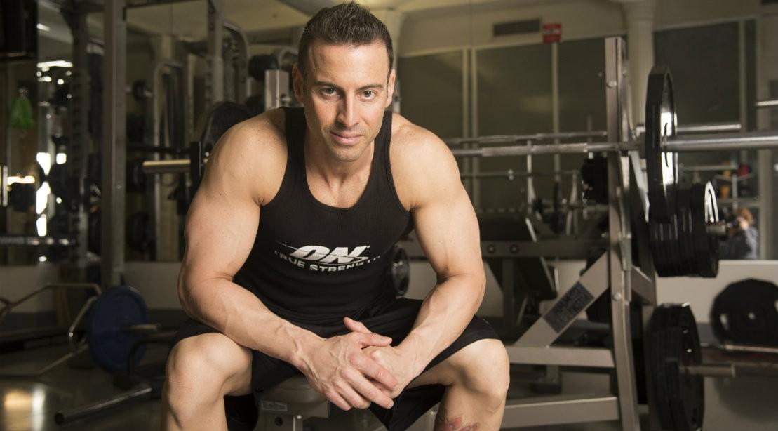 Man Sitting On Bench In Gym