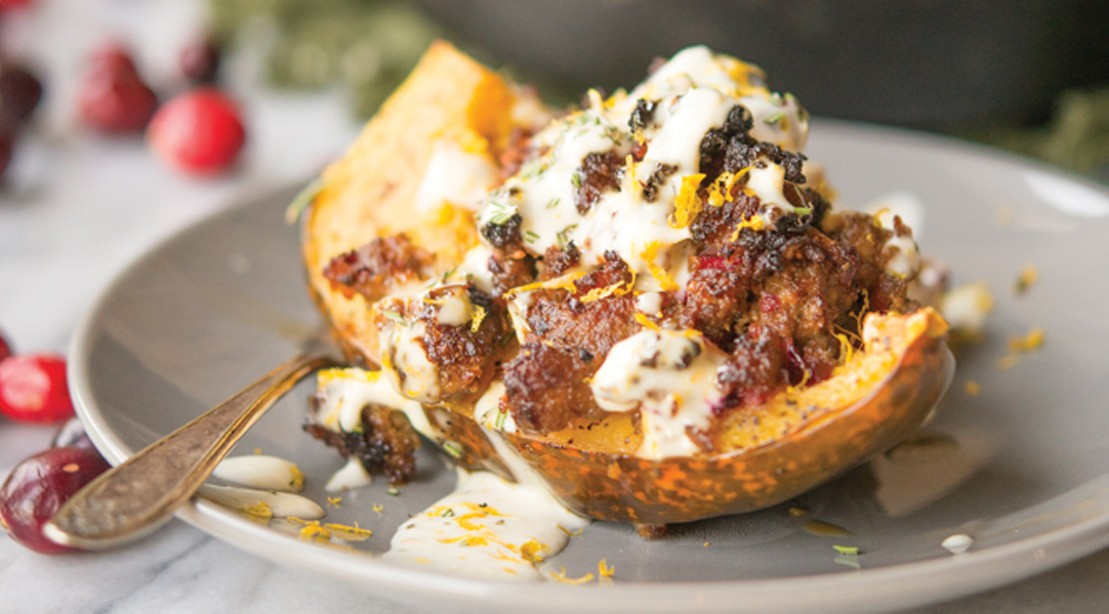 Sausage and Cranberry Stuffed Acorn Squash With Rosemary Orange Cream Sauce