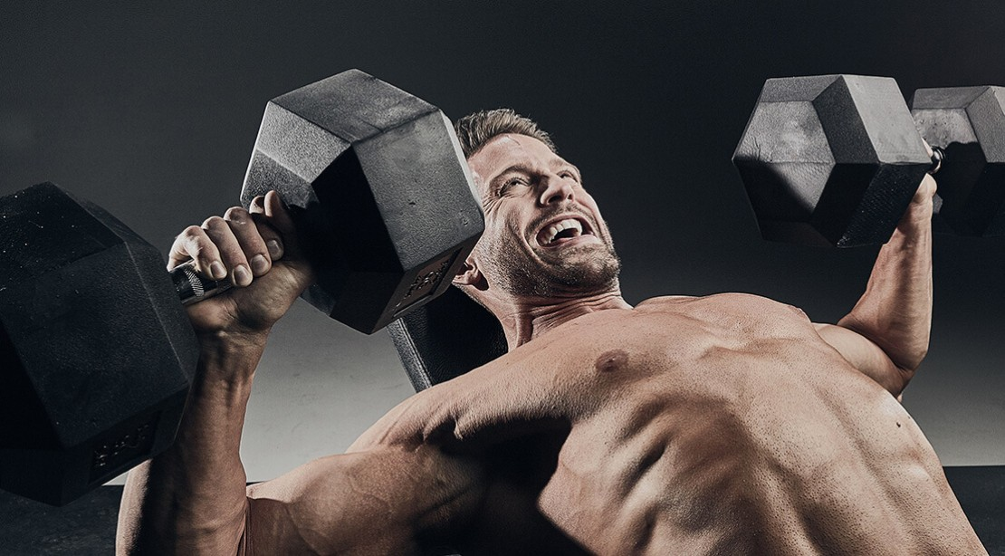 Man Performing Dumbbell Press